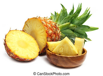 Closeup of sliced pineapple over white background