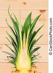 Sliced pineapple located on the wooden background