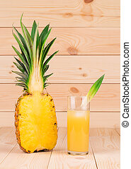 Sliced pineapple over wooden background in the closeup