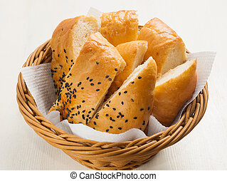 sliced pita bread with sesame seeds in a wicker basket