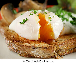 Sliced Poached Egg - Sliced poached egg breakfast with...