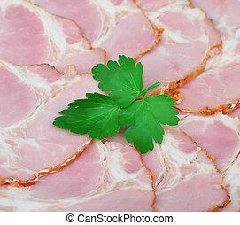 Sliced pork bacon with parsley
