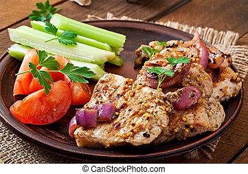Sliced pork grilled with vegetables on ceramic brown plate