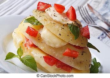 sliced potatoes baked with mozzarella, tomato horizontal