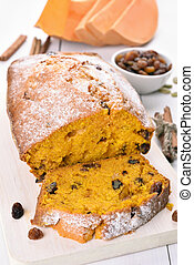Sliced pumpkin bread loaf with nuts, raisin and cinnamon