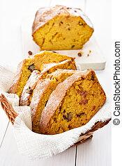Sliced pumpkin loaf with nuts, cinnamon and raisin