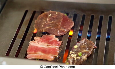 Sliced raw beef on grill bbq