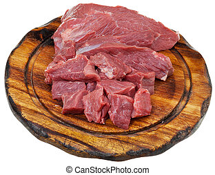 sliced raw meat on cutting wooden board