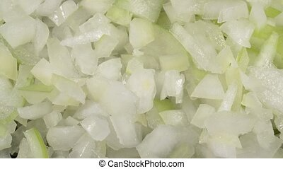 Sliced raw onion. The onion is shredded in small cubes. Ingredients for cooking close-up.
