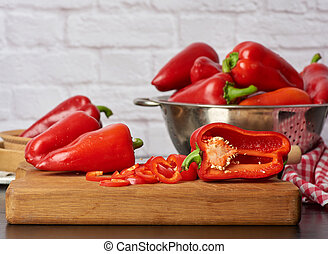sliced red pepper on a cutting wooden board