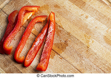 Sliced red pepper on a wooden Board.