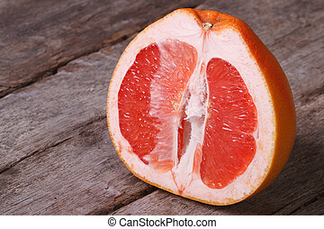 Sliced ripe grapefruit on an old wooden table