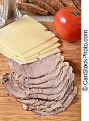 Sliced roast beef and swiss cheese