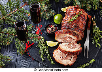 sliced roast pork roulade with red wine