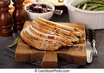 Sliced roasted turkey for Thanksgiving or Christmas dinner
