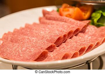Sliced Salami on Plate