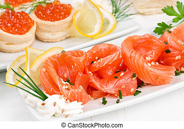 Sliced ??salmon and canape withcaviar