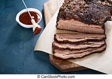 Sliced slowly cooked brisket with bbq sauce