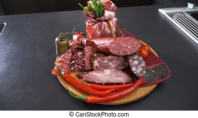 Sliced smoked sausage and ham - Dish with meat and sausage...