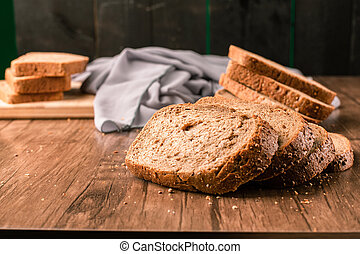 Sliced toast bread on a wooden table