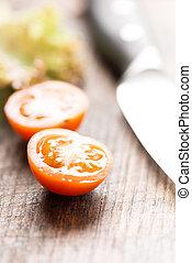 Sliced tomato on cutting board vertical macro