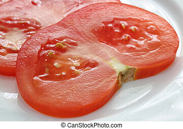 sliced tomato on white plate