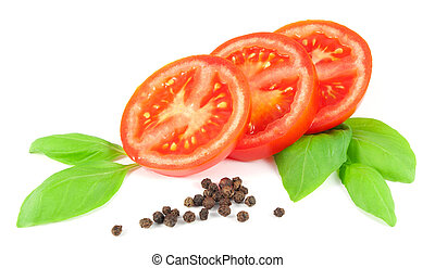 Sliced tomato with basil leaves