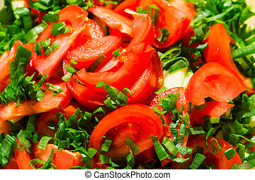 Sliced tomatoes background with green onions