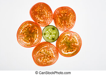 Sliced vegetables - Larger pieces of tomato surround ...