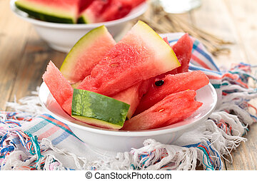 Sliced watermelon in plate. - Closeup shot of fresh sliced...