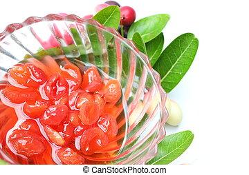 Sliced welded carissa carandas fruits on white background