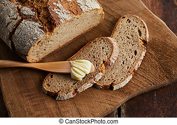 Slices and loaf of fresh crusty rye bread