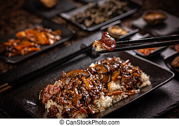 Slices of beef in spicy brown sauce