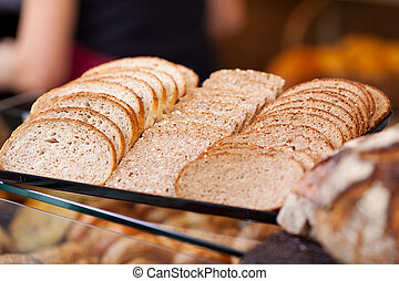 slices of bread arranged on counter of a bakery