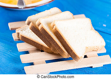 Slices of bread on the blue wooden background