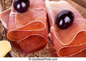 slices of bread with spanish serrano ham