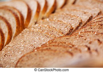 Slices Of Brown Bread In Bakery - Selective focus of slices ...