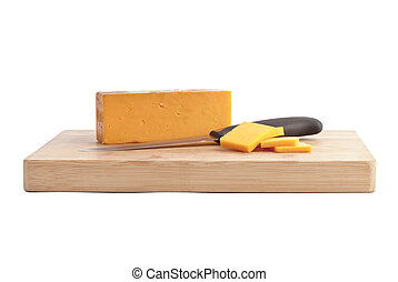 slices of cheddar cheese on a wooden board