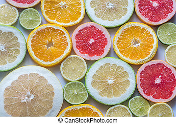 Slices of citrus fruits: top view