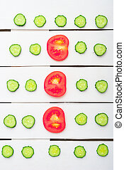 slices of cucumber and red tomatoes