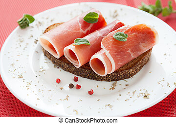 slices of delicious ham rolled into a tube on a plate