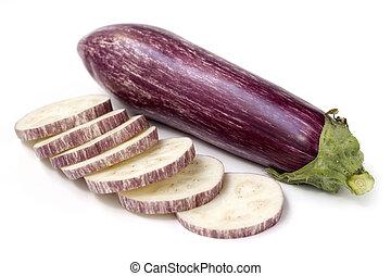 slices of eggplant and whole fruit on white background