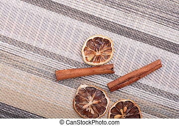Slices of fresh dried lemon, orange and spices for cooking or baking