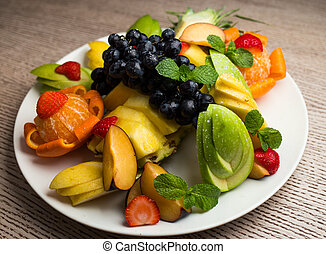 slices of fresh fruit with grapes