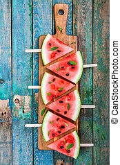 Slices of fresh juicy watermelon on a cutting board