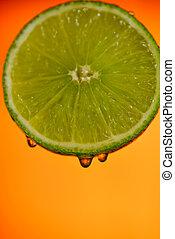slices of fresh lemon on background
