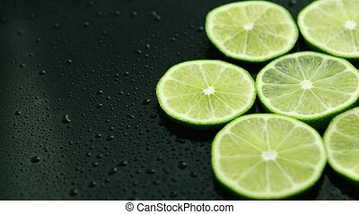 Slices of fresh lime - From above slices of fresh green sour...
