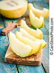 slices of fresh melon on cutting board