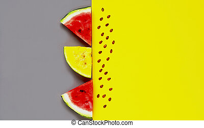 Slices of fresh watermelon on yellow and gray background. Trending colors of 2021. Creative food mockup.