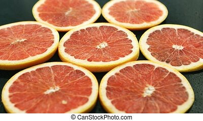 Slices of grapefruit on table
